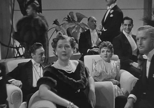 С Джоном Бэрримором и Клодетт Кольбер в фильме «Полночь» (1939, реж. М. Лейзен)